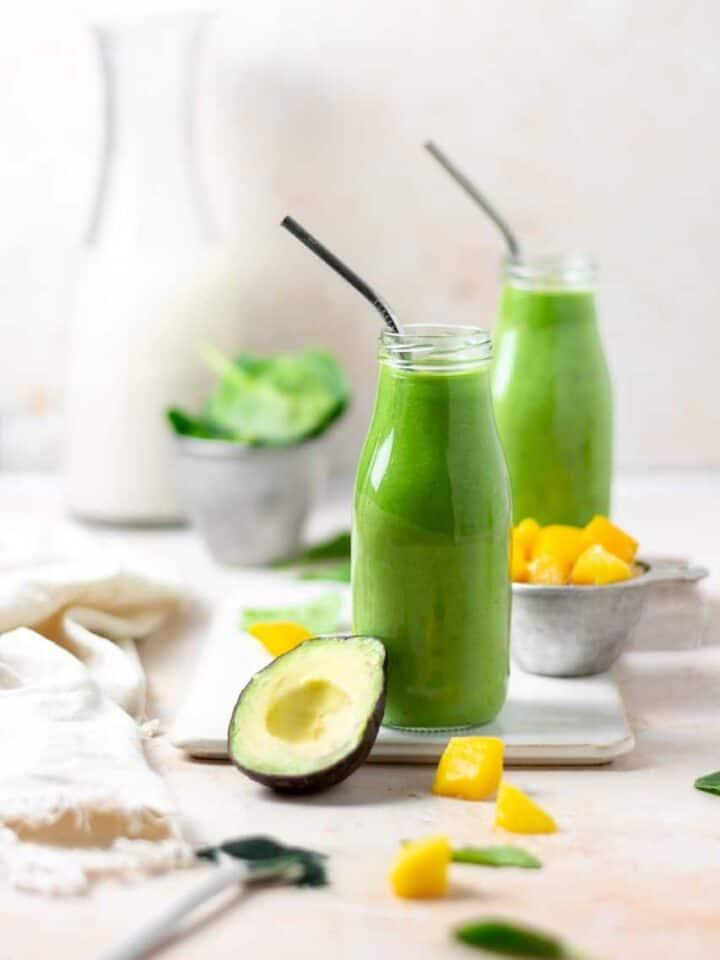 Creamy Avocado Spirulina Smoothie made with avocado, mango, banana, spinach, spirulina powder, flax seeds, lemon juice, soy milk