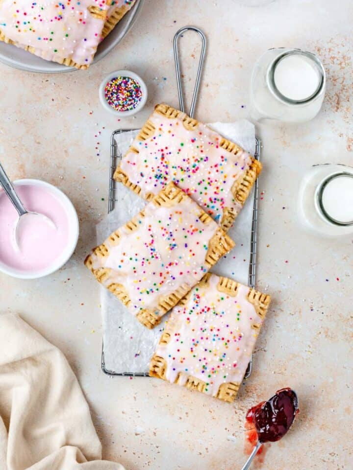 Homemade Vegan Strawberry Poptarts topped with pink vanilla icing and sprinkles