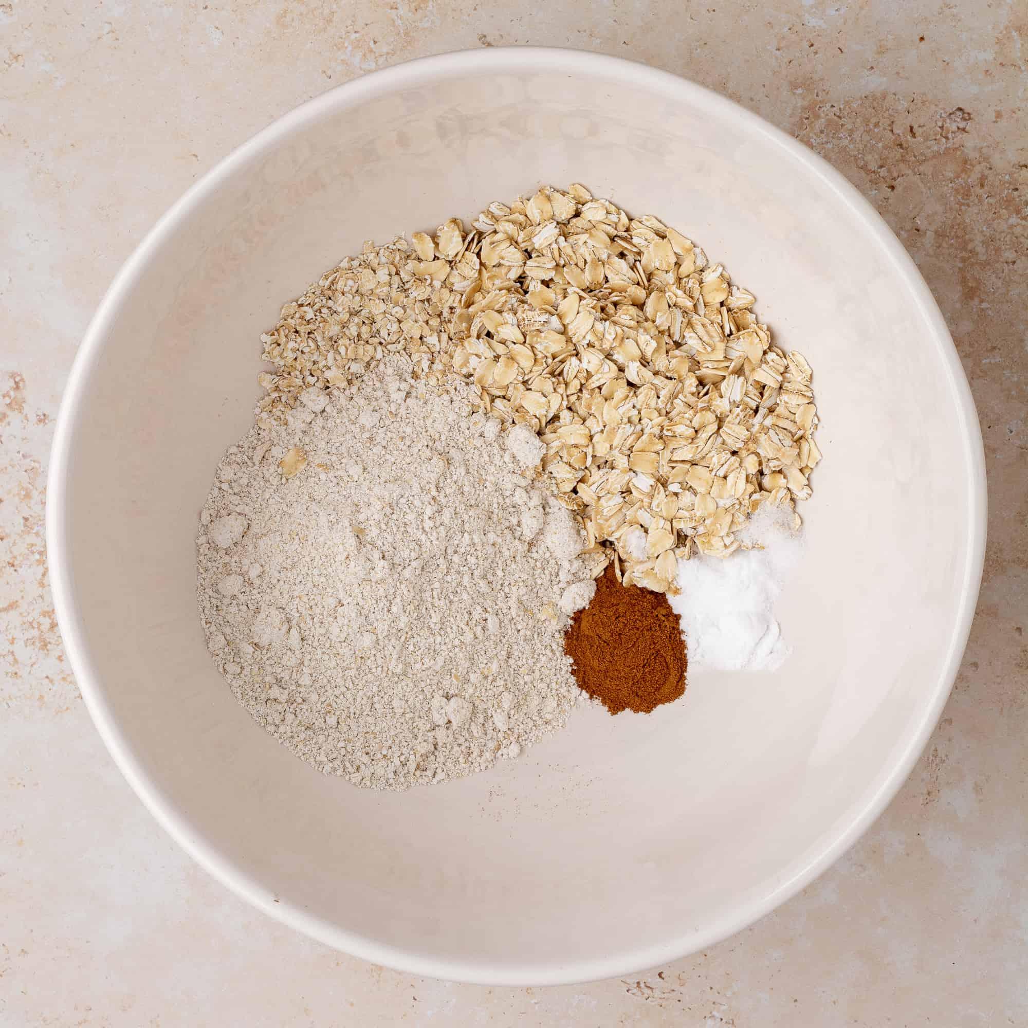 oat flour, oats, cinnamon, baking soda, and salt in a bowl