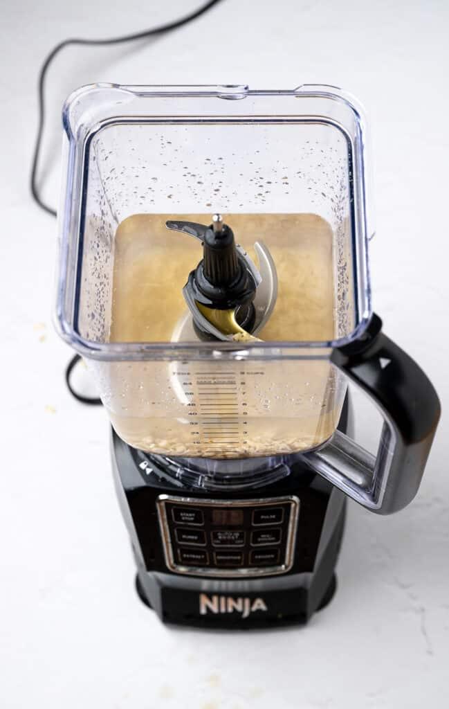 ingredients for oat milk in a blender