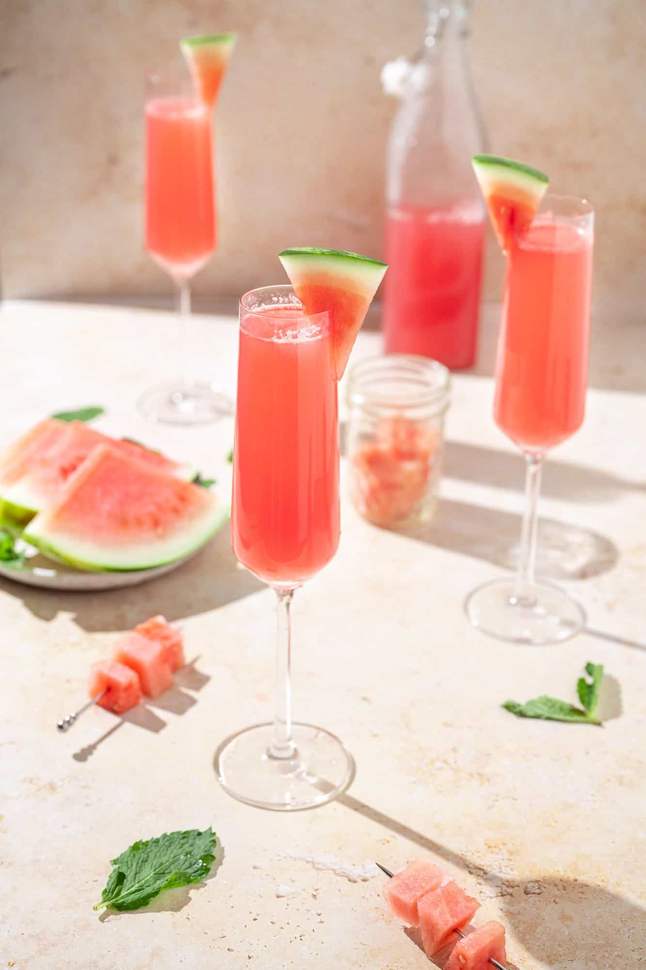 watermelon mimosas in champagne flutes