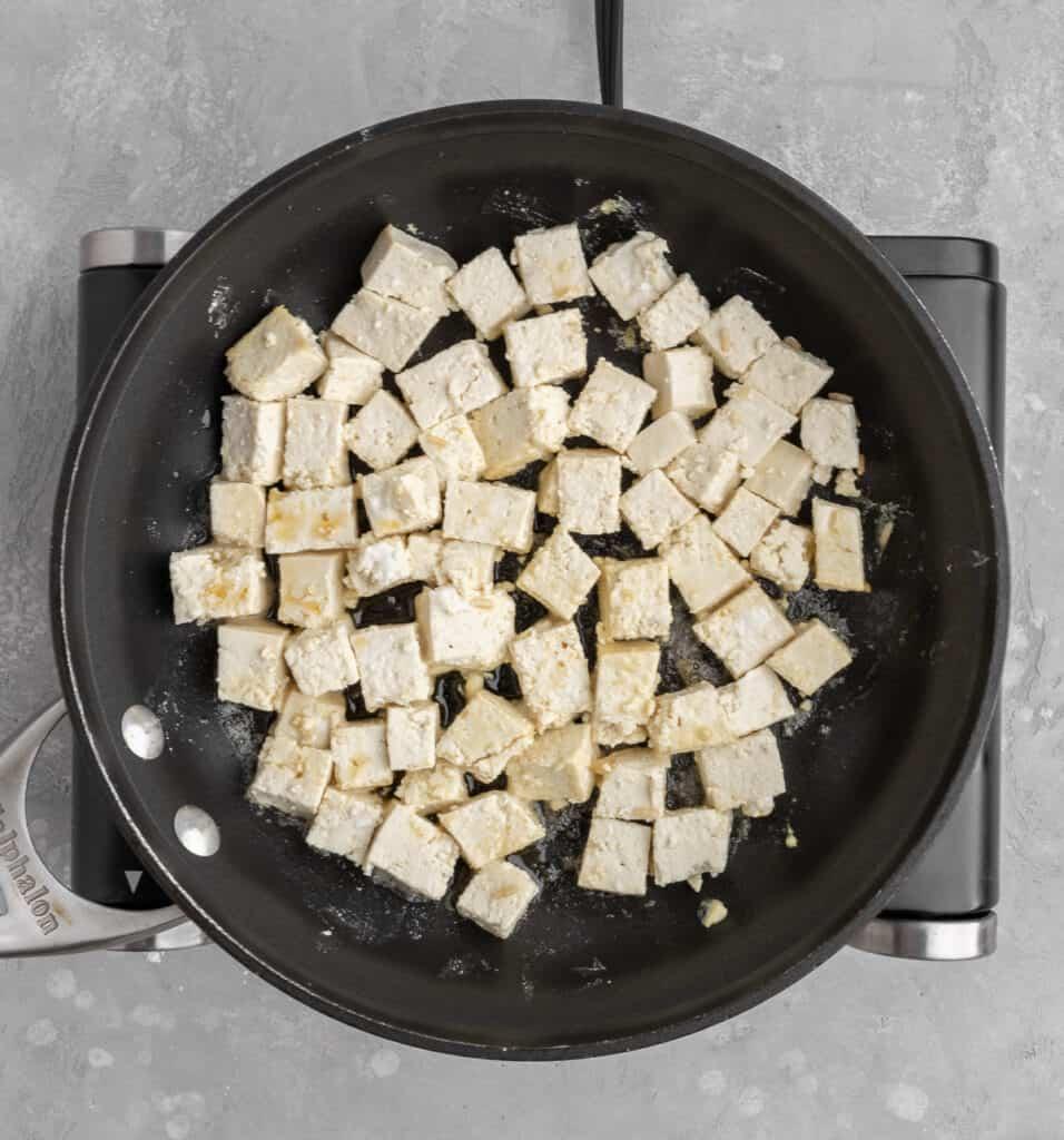 cubed tofu in a pan