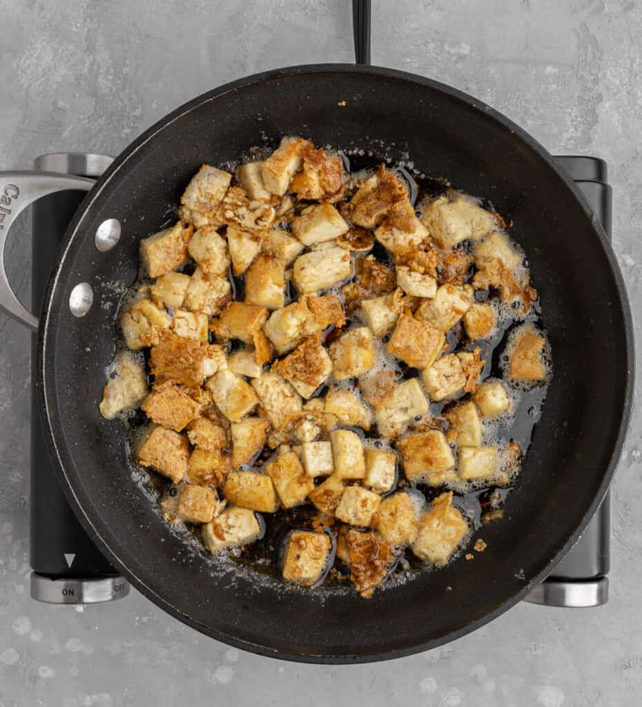 pan fried tofu in a pan with sauce