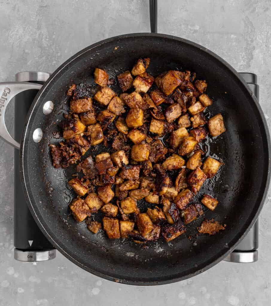 sesame ginger glazed tofu in a pan