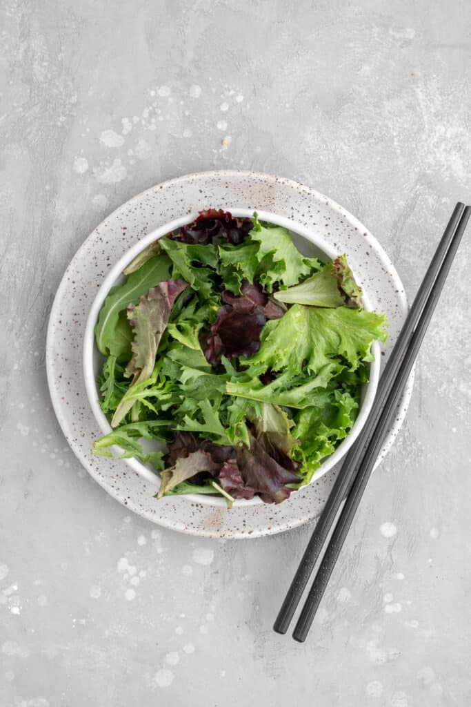 mixed lettuce in a white bowl