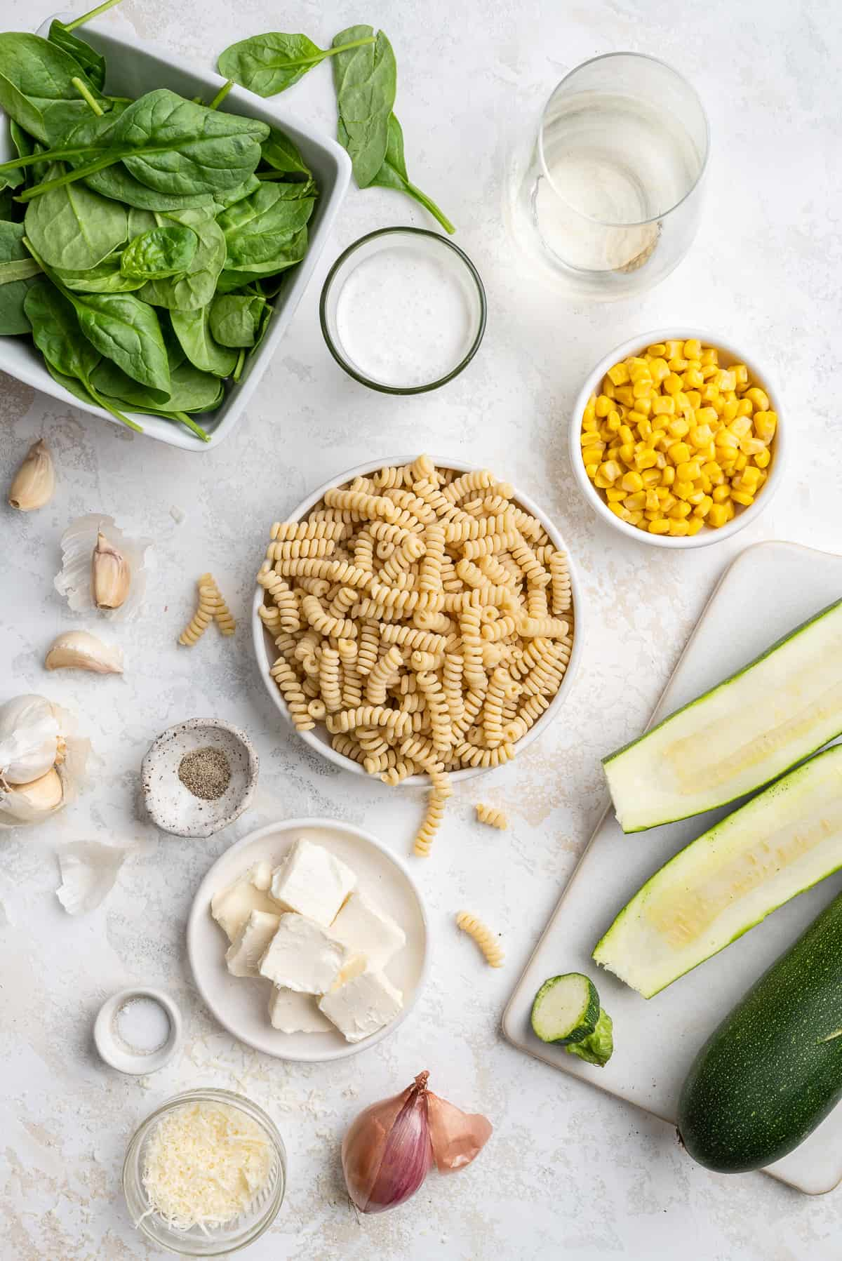 summer pasta ingredients: fusilli, zucchini, corn, spinach, shallot, garlic, salt, pepper, cheese, butter, white wine, heavy cream
