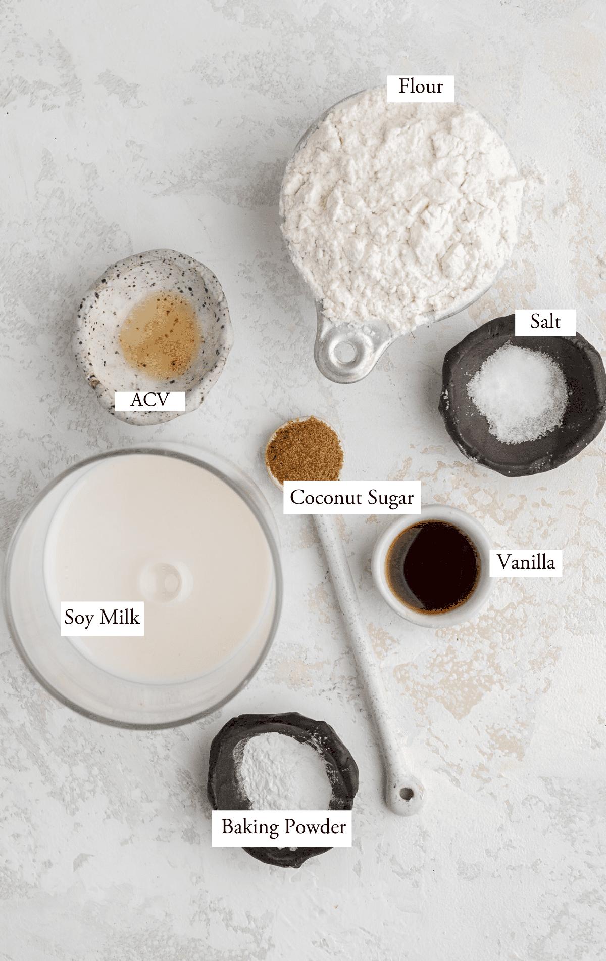Vegan buttermilk pancake ingredients: milk, ACV, flour, baking powder, coconut sugar, vanilla, salt