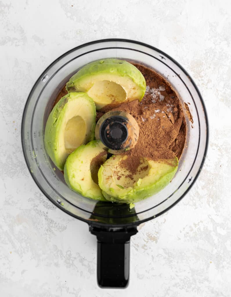 pitted avocados, cocoa powder, maple syrup, sea salt, vanilla in a food processor unblended