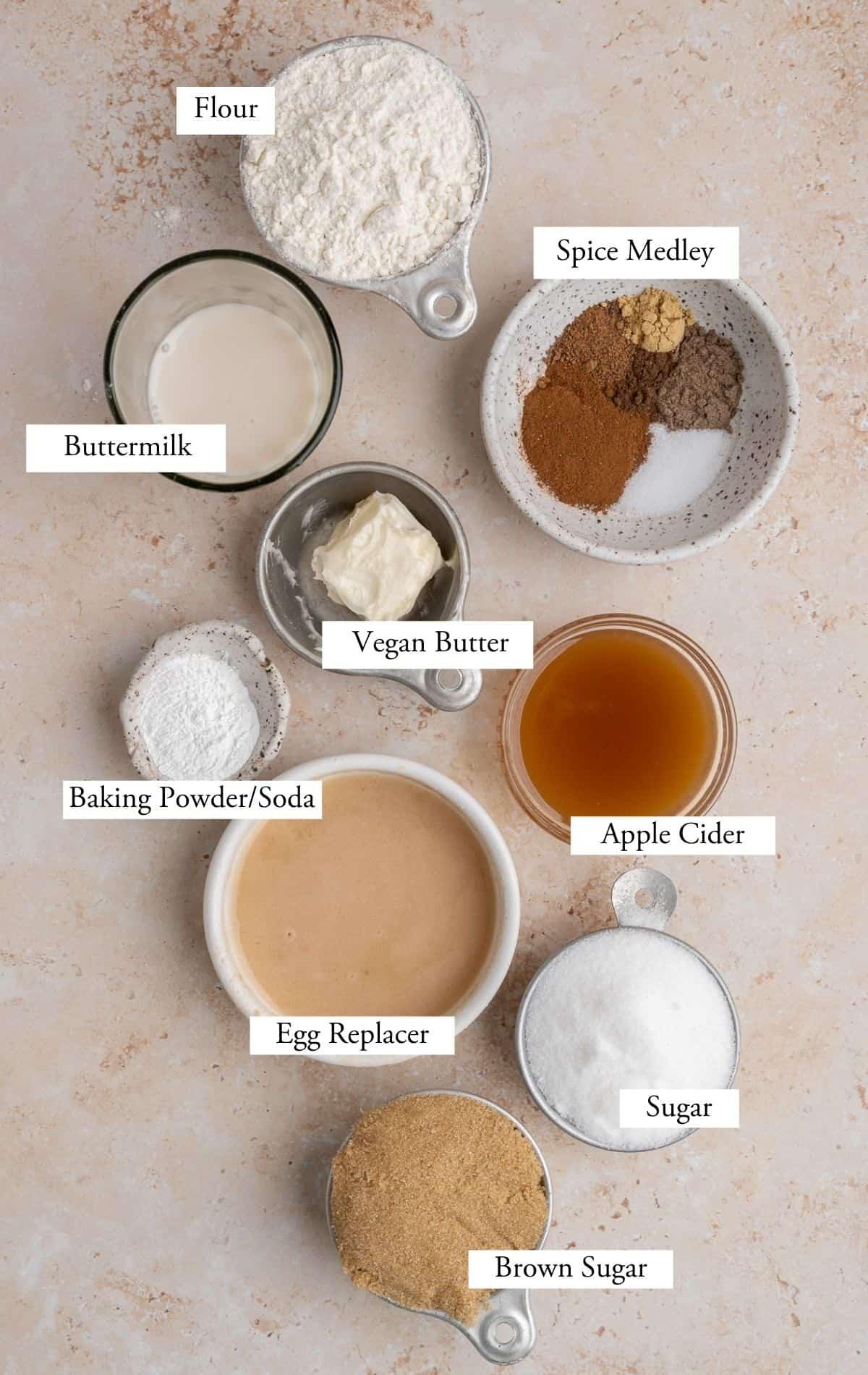 vegan apple cider donut ingredients: flour, apple cider, buttermilk, sugars, spices, baking powder & soda, egg replacer.