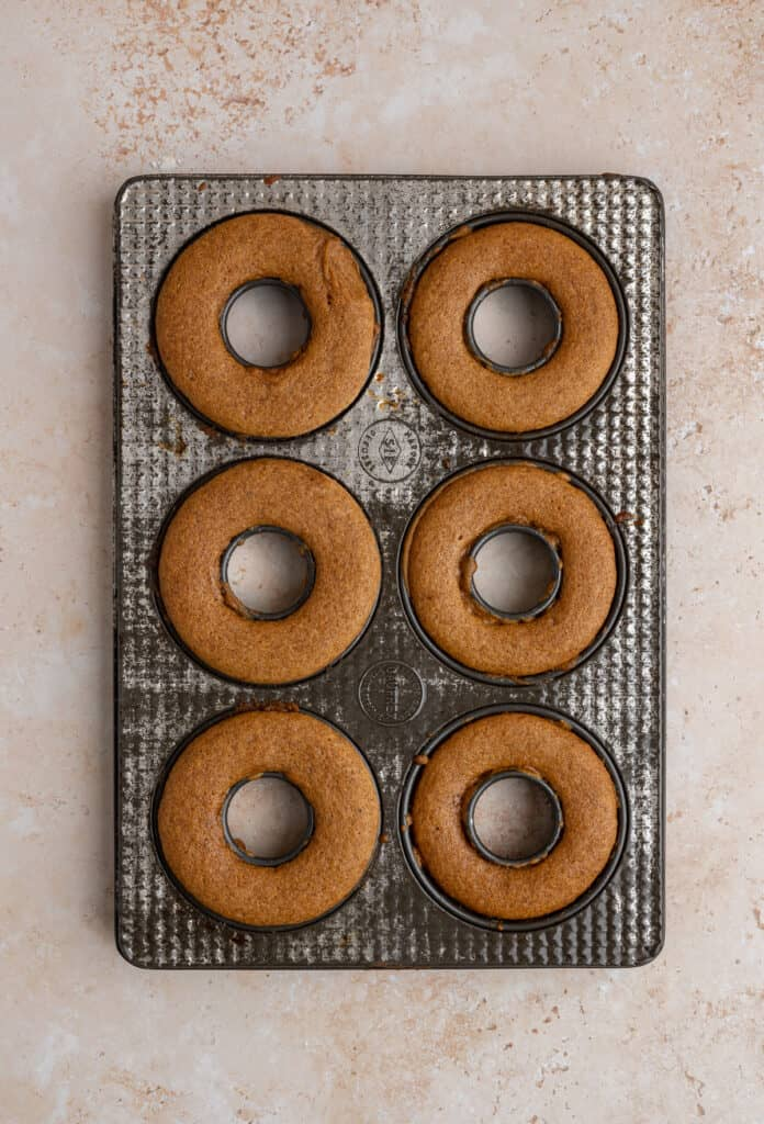 baked apple cider donuts in an antique donut pan.
