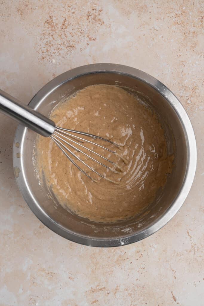 apple cider donut batter in a bowl.