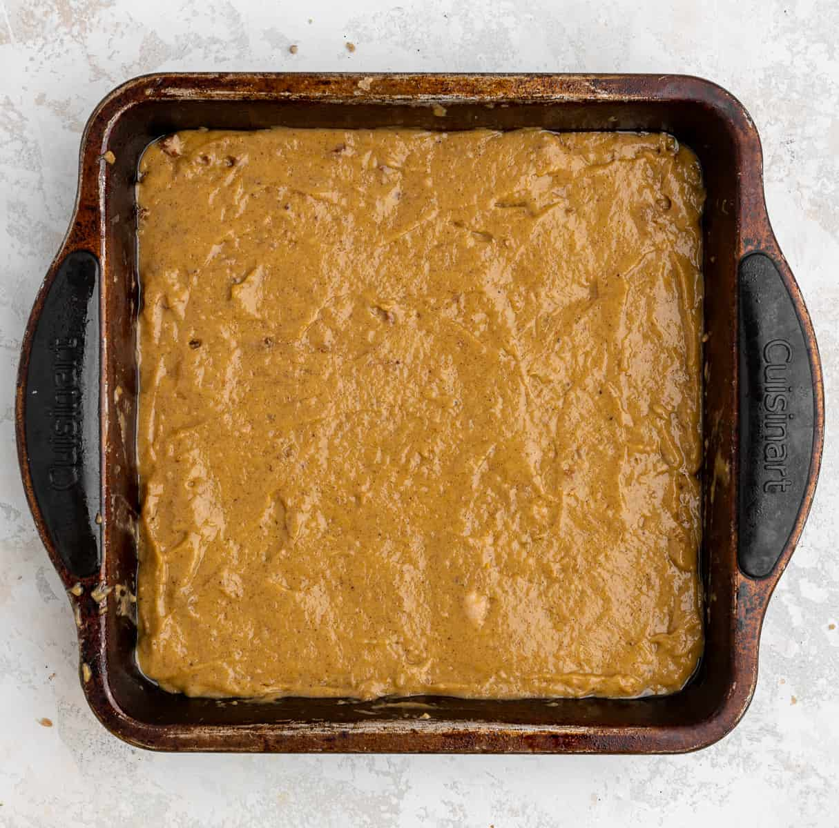 pumpkin coffee cake in a greased 8x8 baking dish, unbaked.