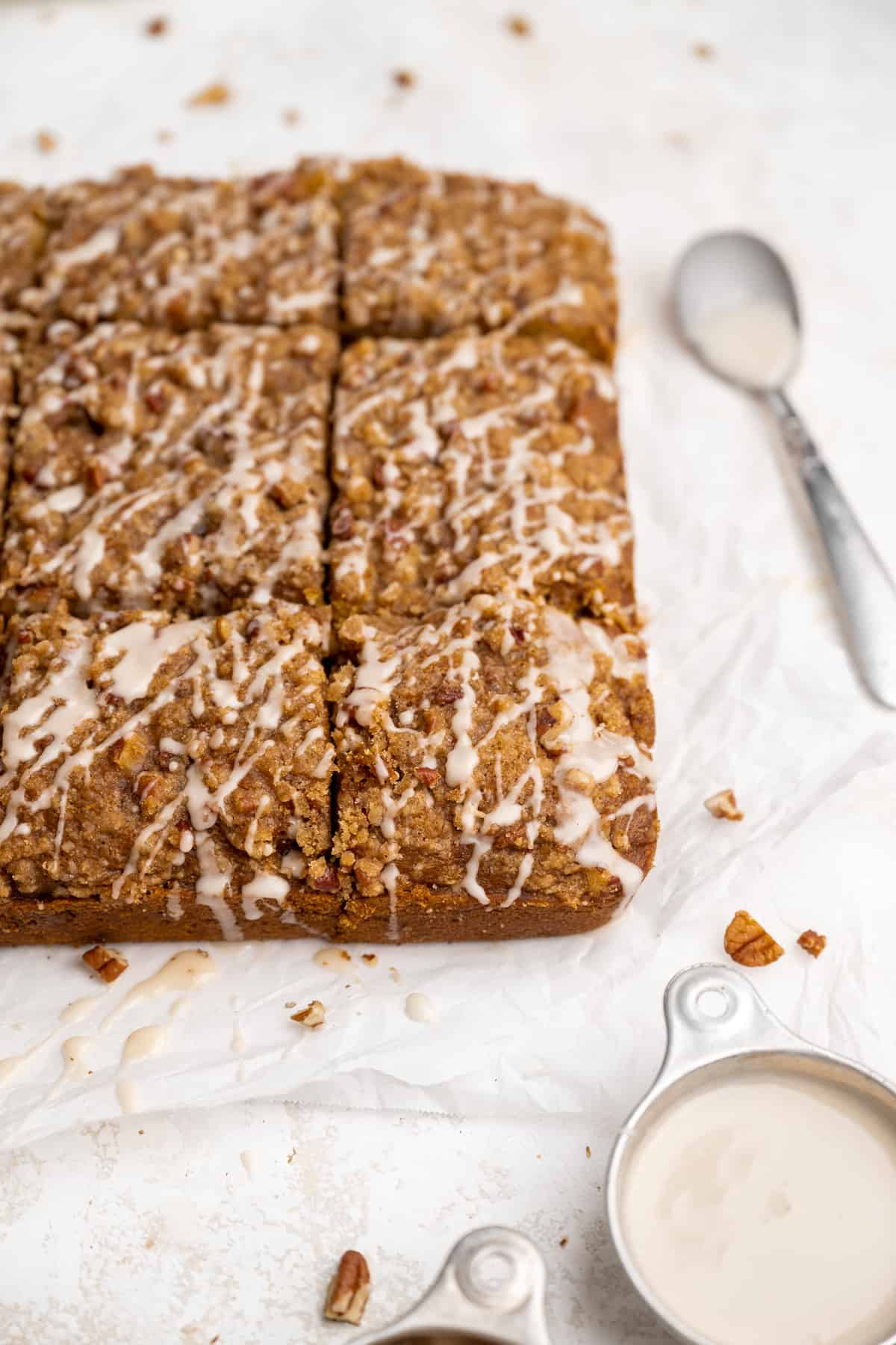 9 squares of vegan pumpkin coffee cake on parchment paper